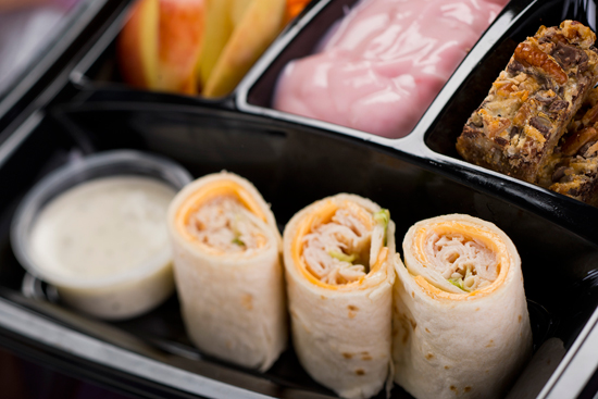 Turkey and American Cheese Wrap with Apples and Carrots with Ranch Dip, Strawberry Yogurt and Seven-Layer Cookie Bar Available with Fantasmic! Seats at Disney's Hollywood Studios