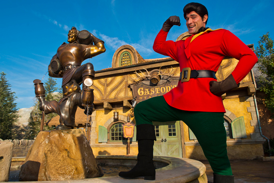 Gaston and his Statue in Front of Gaston's Tavern in New Fantasyland at Magic Kingdom Park