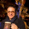 Actor Andy Garcia poses December 5, 2012 with a mug of 'LeFou's Brew' at Gaston's Tavern in New Fantasyland at the Magic Kingdom theme park in Lake Buena Vista, Fla. LeFou's Brew is a non-alcoholic, no-sugar added frozen apple juice with a hint of toasted marshmallow, topped with all-natural passion fruit-mango foam.