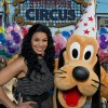 Singer Jordin Sparks poses Dec. 6, 2012 with Pluto in the 'Storybook Circus' area of New Fantasyland at the Magic Kingdom theme park in Lake Buena Vista, Fla.  Sparks was one of the celebrities on hand to celebrate today's Grand Opening of New Fantasyland at Walt Disney World Resort.