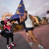 Minnie Mouse cheering the group on during the start of their 2.5-mile run.