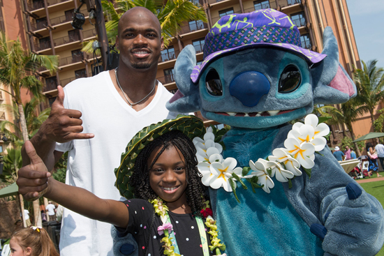 NFL Player Adrian Peterson of the Minnesota Vikings with Stitch at Aulani, a Disney Resort & Spa for the Aulani Pro Bowl Reception