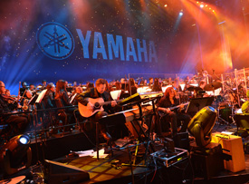 A 60-piece orchestra led by Nathan East and James Newton Howard performs during Yamahas 125th Anniversary Concert