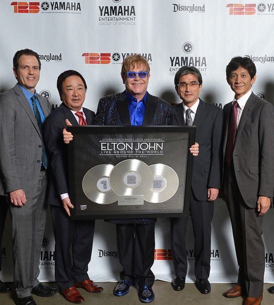 Yamaha Executives Present Elton John With a Special Gift