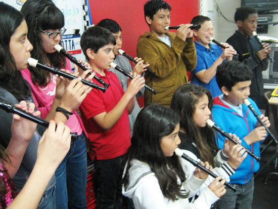 Students Learning to Read and Play Music on Recorders