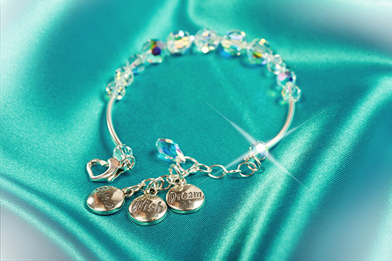Sterling Silver Bracelet With Sparkling Swarovski Srystals and Three Charms Featuring the Words 'Dream,' 'Wish' and 'Believe'