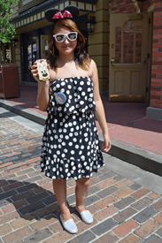 A Graphic Take in Black and White, we Love How the Accessories Pop From the Pink Minnie Bow and Cell Phone Cover to the White Sunnies and Silver Flats