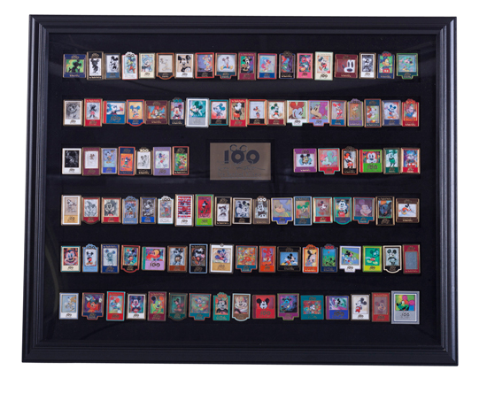 Developed in 2002 in Celebration of the 100th Birthday of Walt Disney, this Framed Commemorative Pin Set Includes One-Hundred Limited-Edition Pins Inspired by the Artwork of Artist Eric Robison