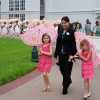 Eva Brackmann and Rachel Pinne Lead the Parasol Parade at Disney's Grand Floridian Resort & Spa