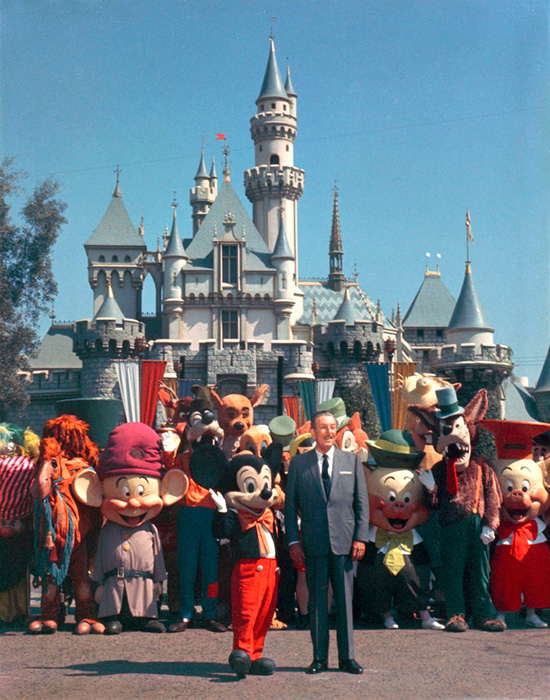 Walt Disney Takes a Photo with Disney Characters in Front of Sleeping Beauty Castle at Disneyland Park in 1965