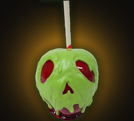 Red Cherry Flavored Candy Apple Covered in Green Chocolate at Sweet Spells in Beverly Sunset on Disney's Hollywood Studios