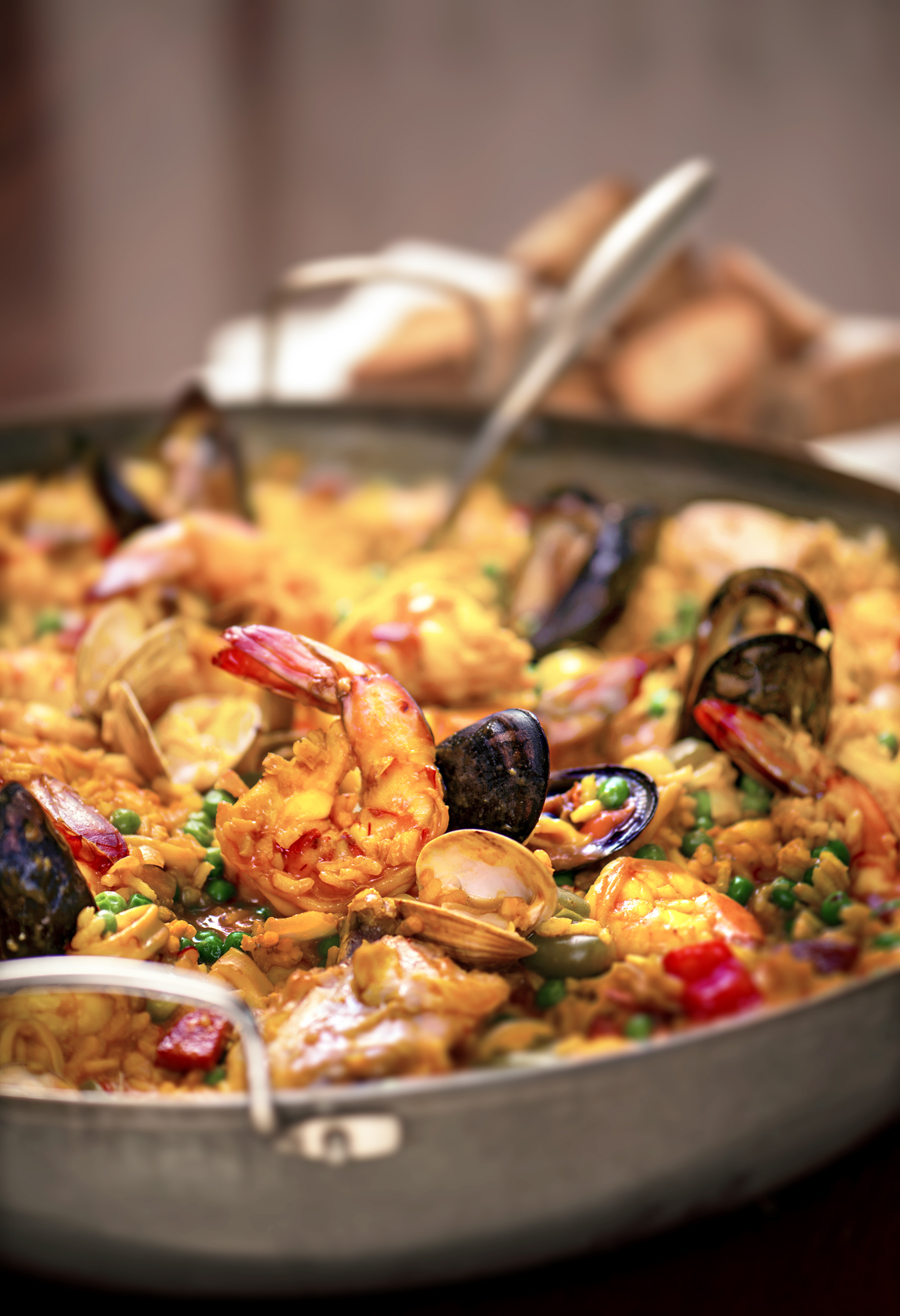 Fresh clams, mussels, chicken, chorizo and prawns are just some of the ...