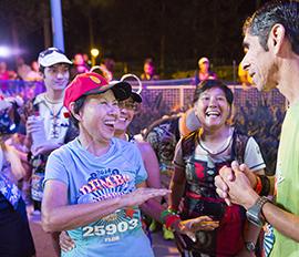 Three Generations Crossing The Disneyland Half Marathon Finish Line Together