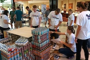 Disney VoluntEARS Put Their 'Can' Do Spirit to Work Helping Central Florida Food Bank