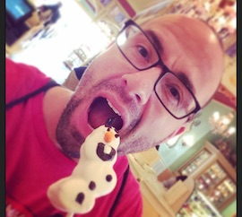 Disney Parks Blog Author Nate Rasmussen Enjoying an Olaf Marshmallow Pop from Disney California Adventure Park