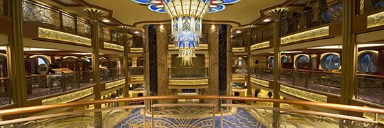 A dazzling chandelier glistens overhead in the expansive, three-deck atrium lobby on the Disney Dream. Descending more than 13 feet from the ceiling, and spanning more than 22 feet in width, the illuminated masterpiece sparkles with thousands of hand-crafted crystal beads. Reminiscent of early 20th century transatlantic ocean liners, contemporary design and Art Deco style grace the grand lobby to exude splendor and sophistication throughout. (Kent Phillips, photographer)
