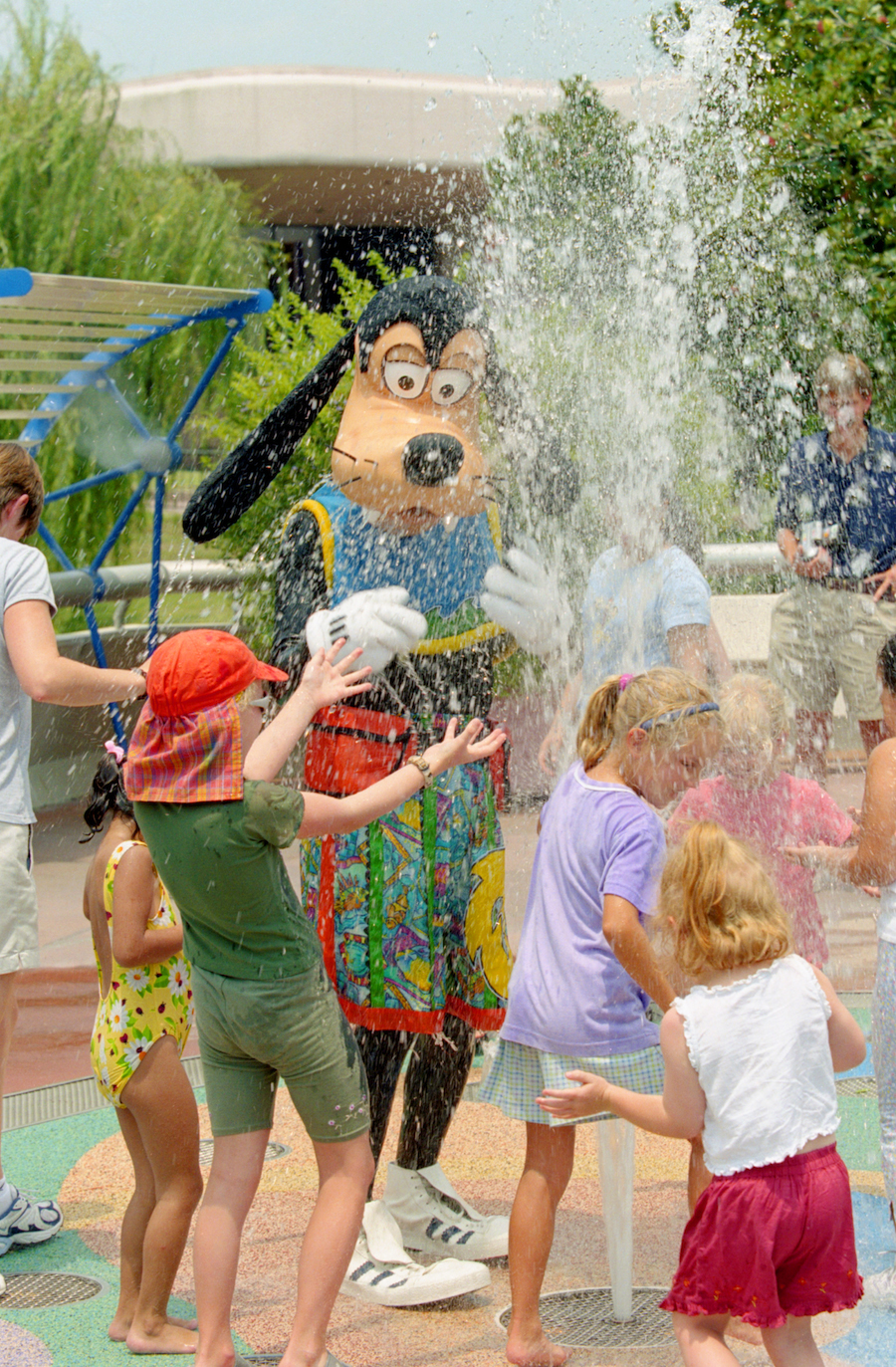 Goofy Keeping Cool in the Splash Pads at Epcot in 2000