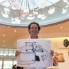 Pixar Animator Robert Baird Signs a Panel of Disney's Art of Animation Resort's Storyboard Chandelier