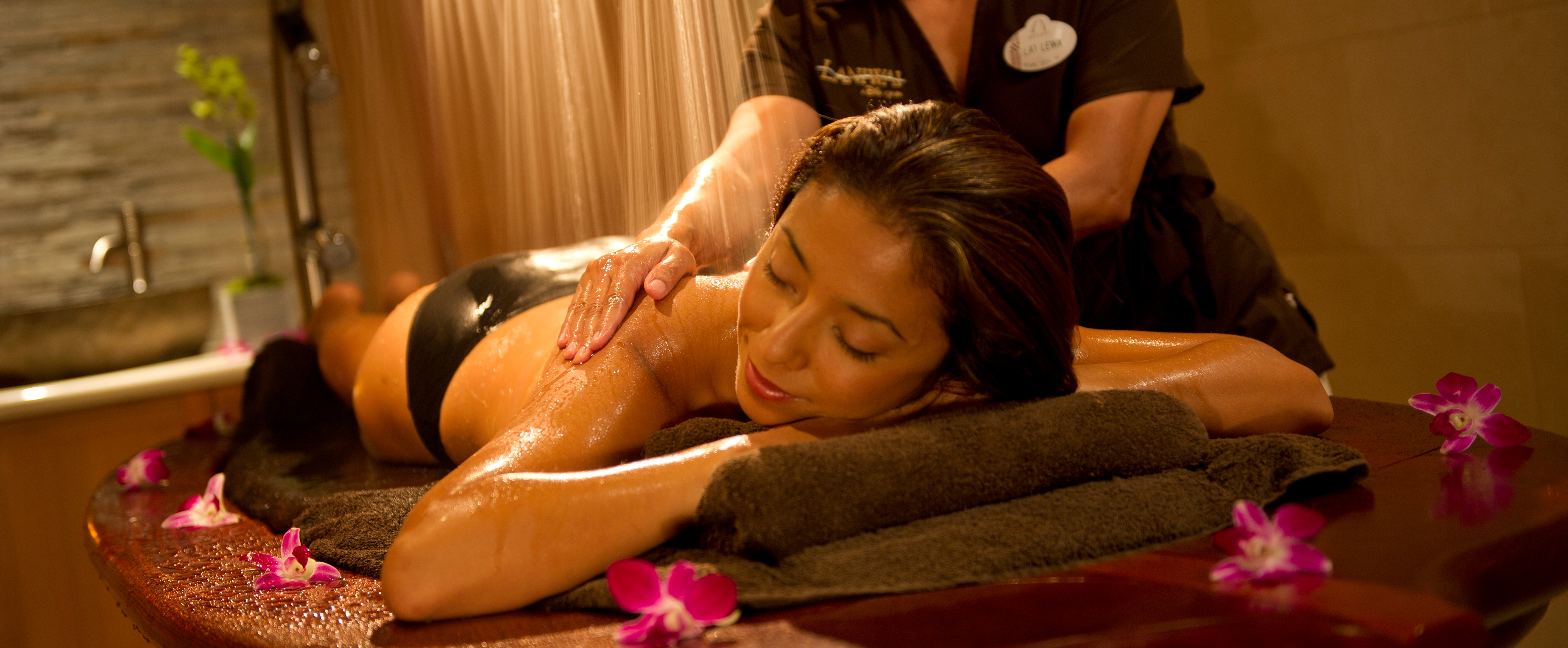 A woman enjoys a massage a Laniwai – A Disney Spa