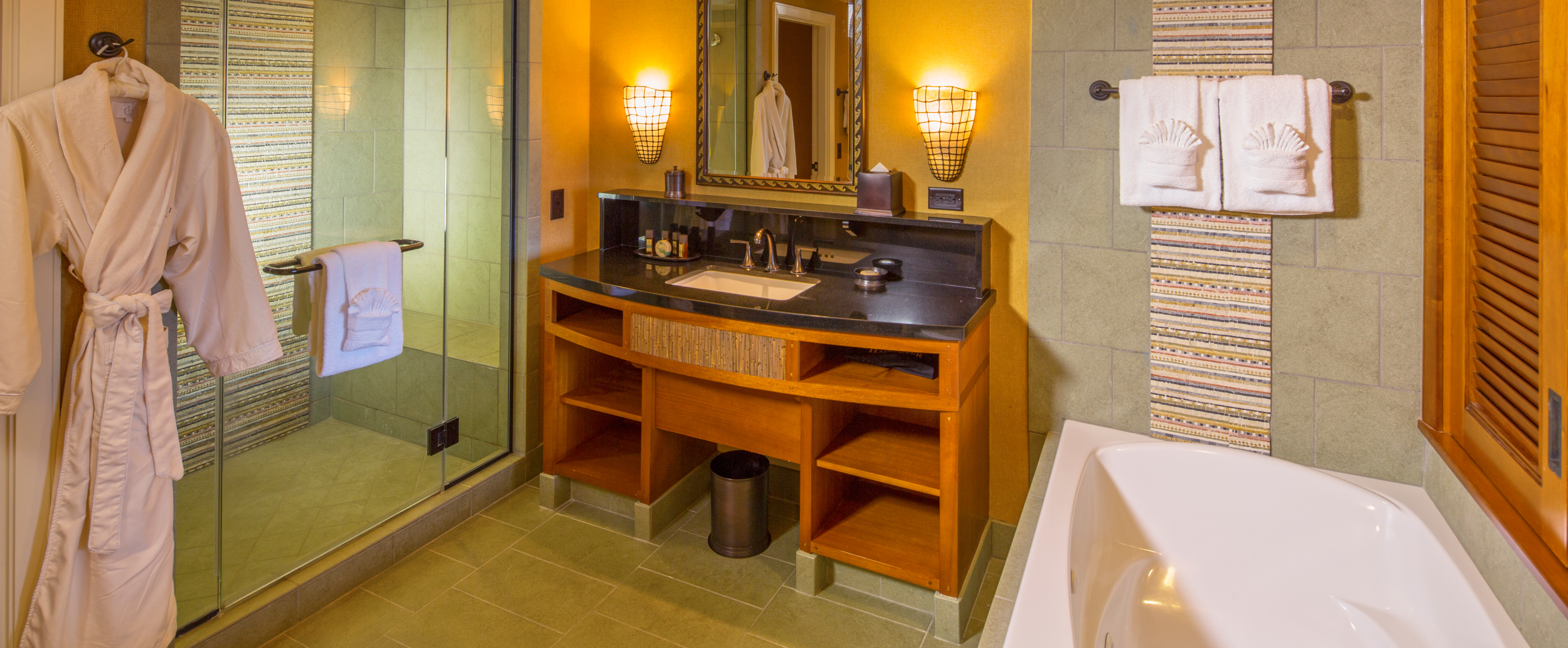 The master bathroom with shower and tub in the 1-Bedroom Suite