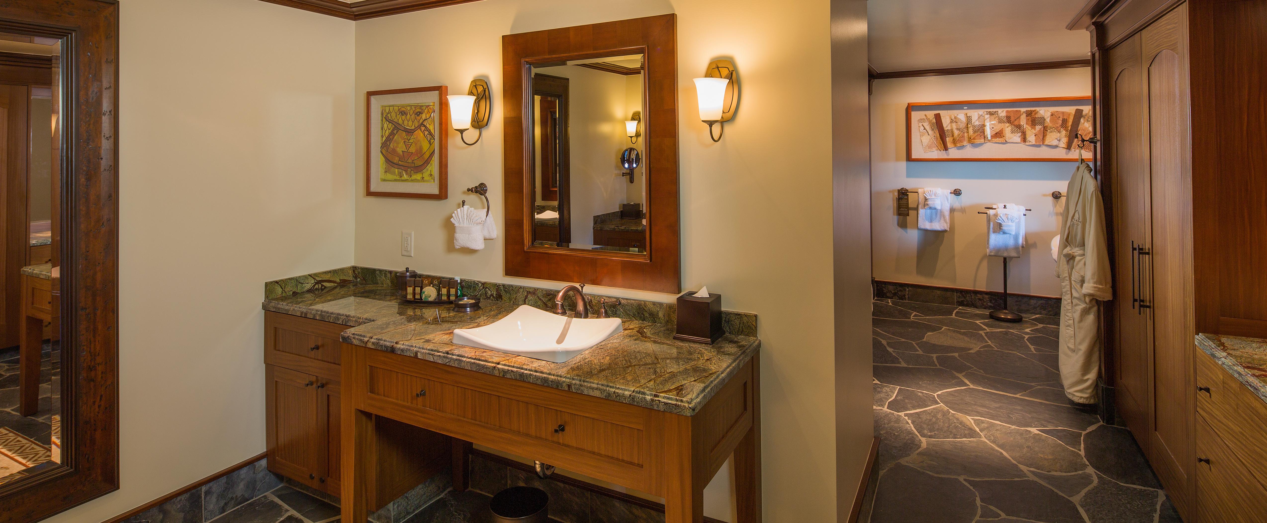 A bathroom vanity in the 2-Bedroom Villa at Aulani