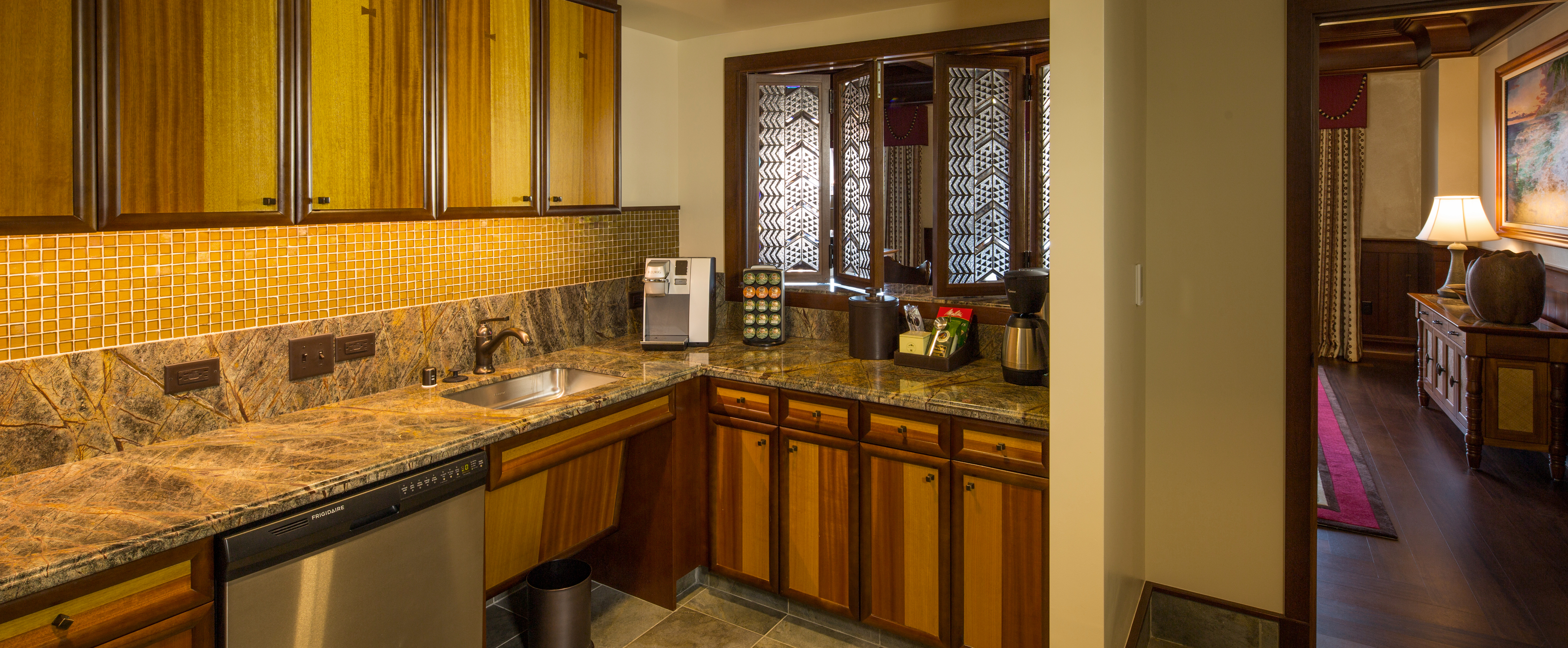 The dining area and butler pantry of the 2-Bedroom Suite at Aulani