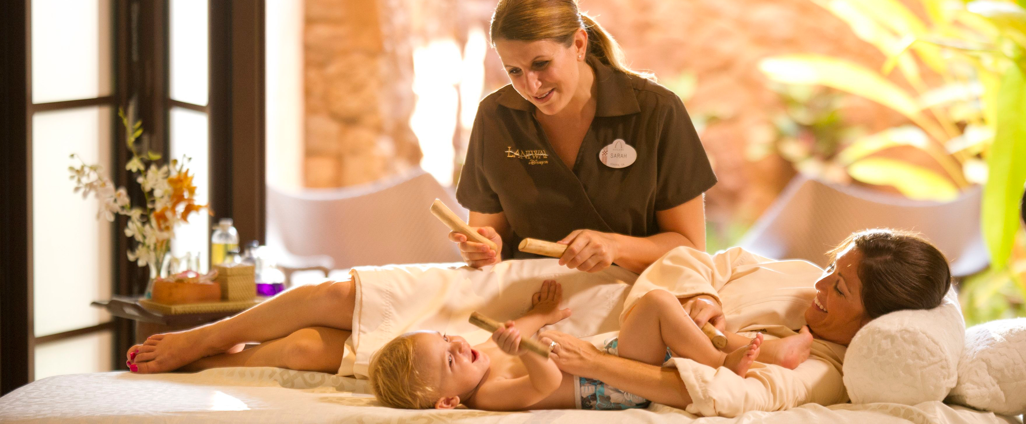A couple shares a massage experience with their infant