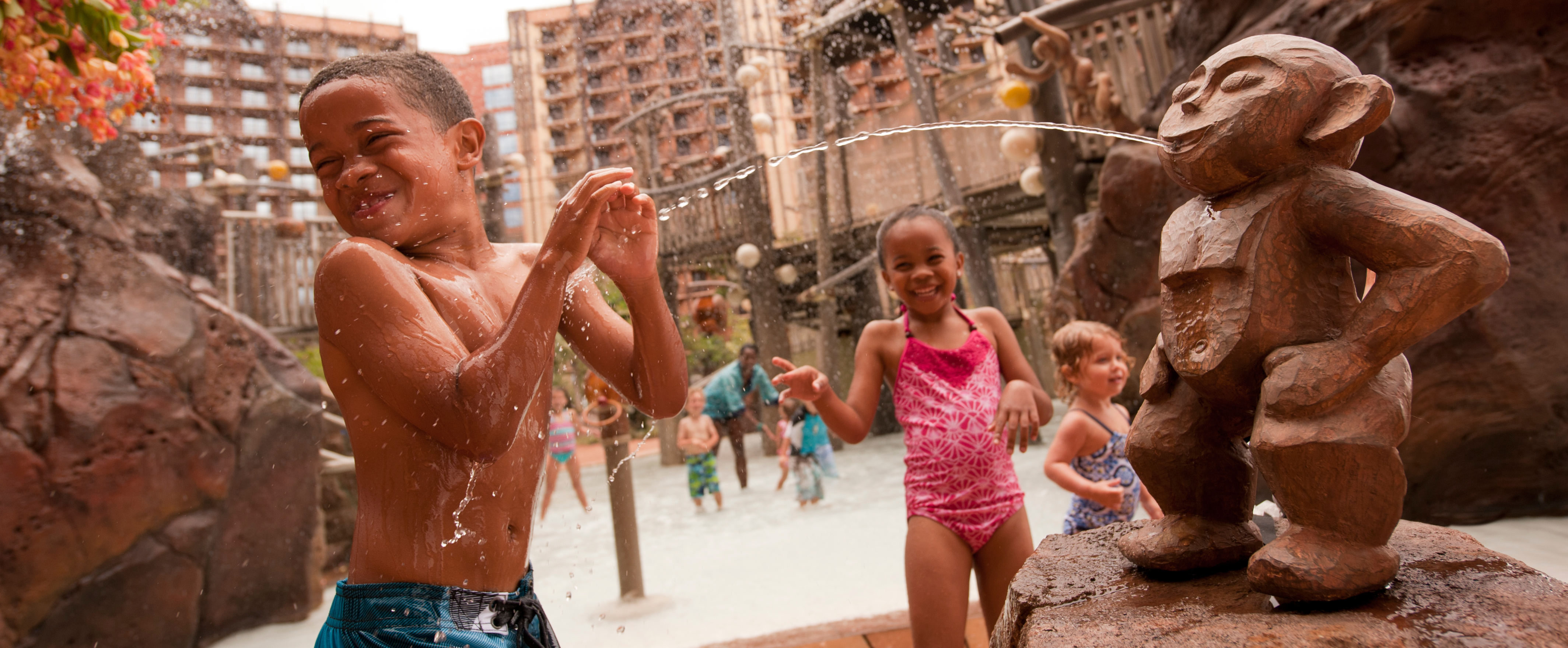 Kids play at Menehune Bridge in the Aulani pool area