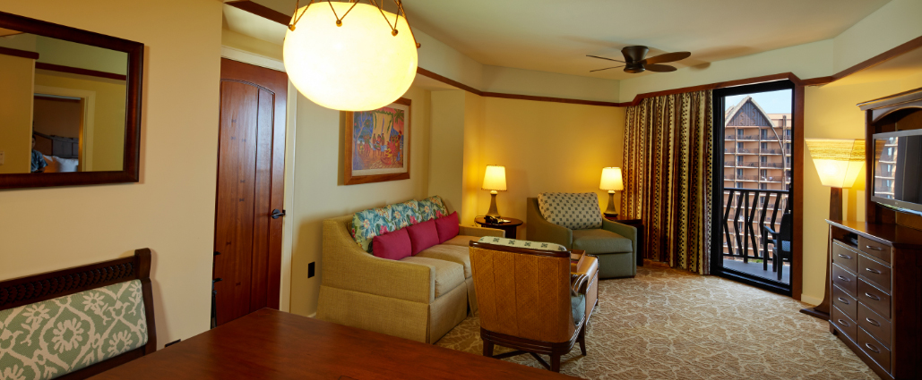 The living area and dining area of the 2-Bedroom Villa at Aulani