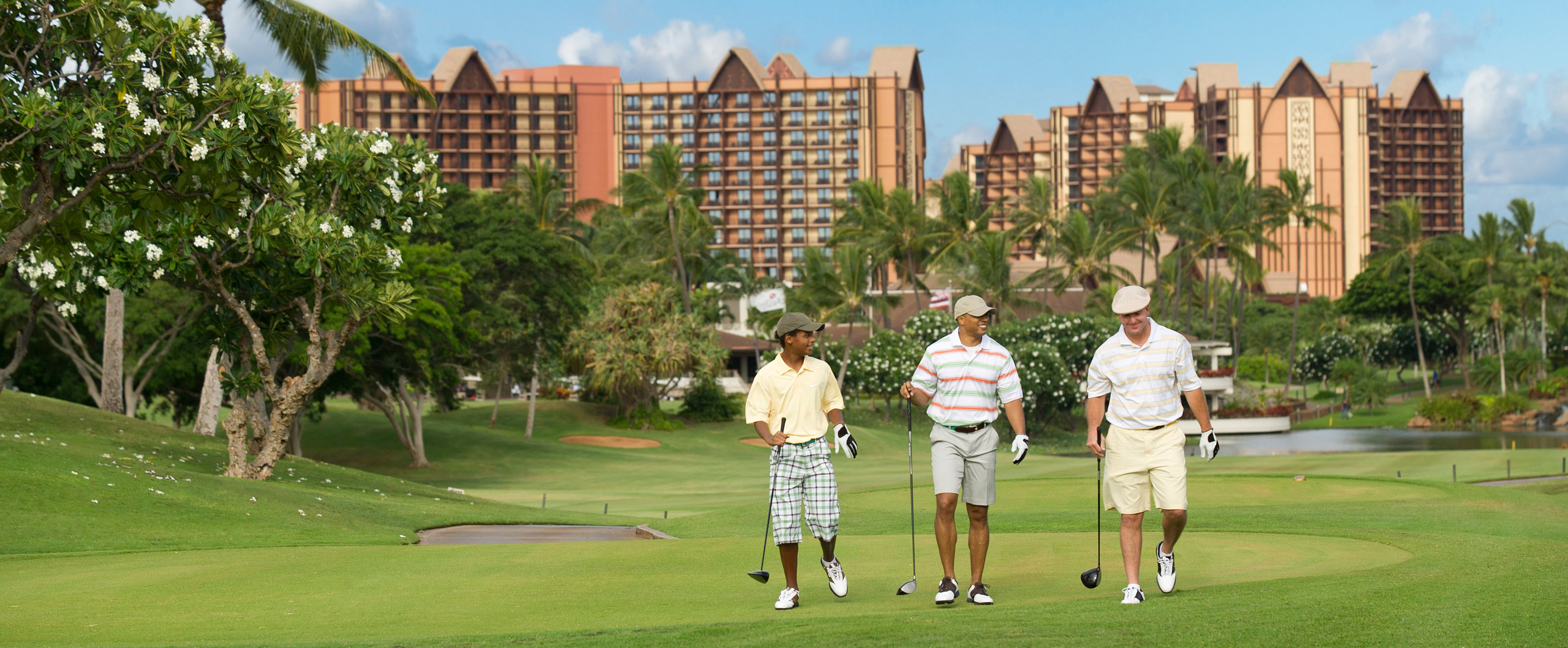 Three men walk the course at Ko Olina Golf Club