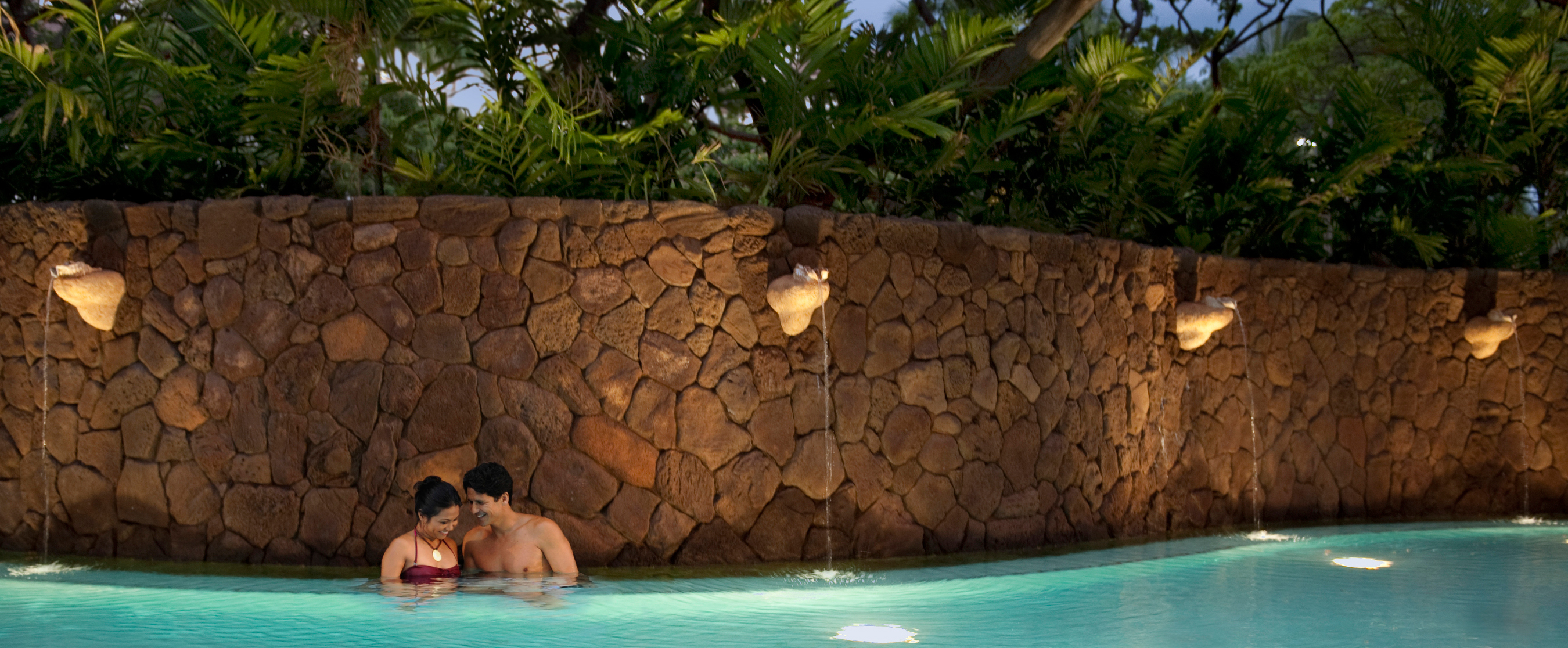 A couple relaxes in Wailana Pool