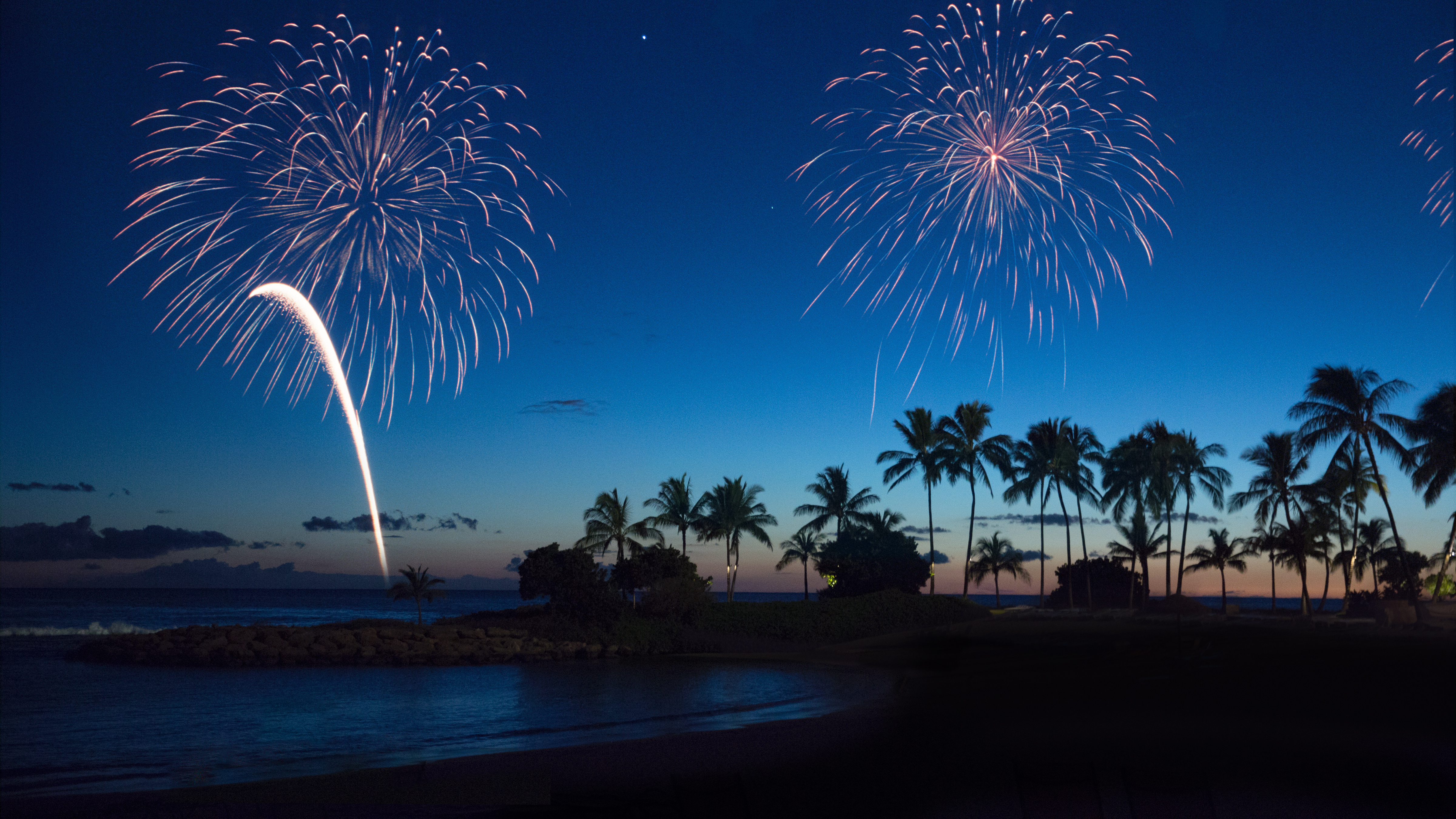 Fireworks over the ocean at Aulani beach