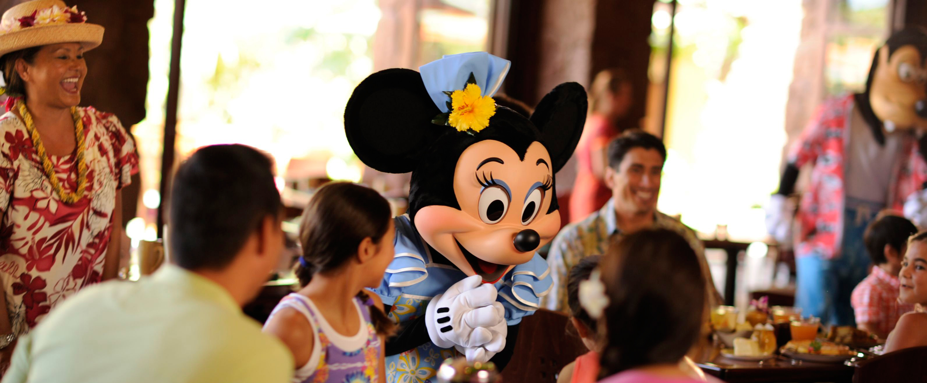 Minnie Mouse greets a family at Makahiki restaurant