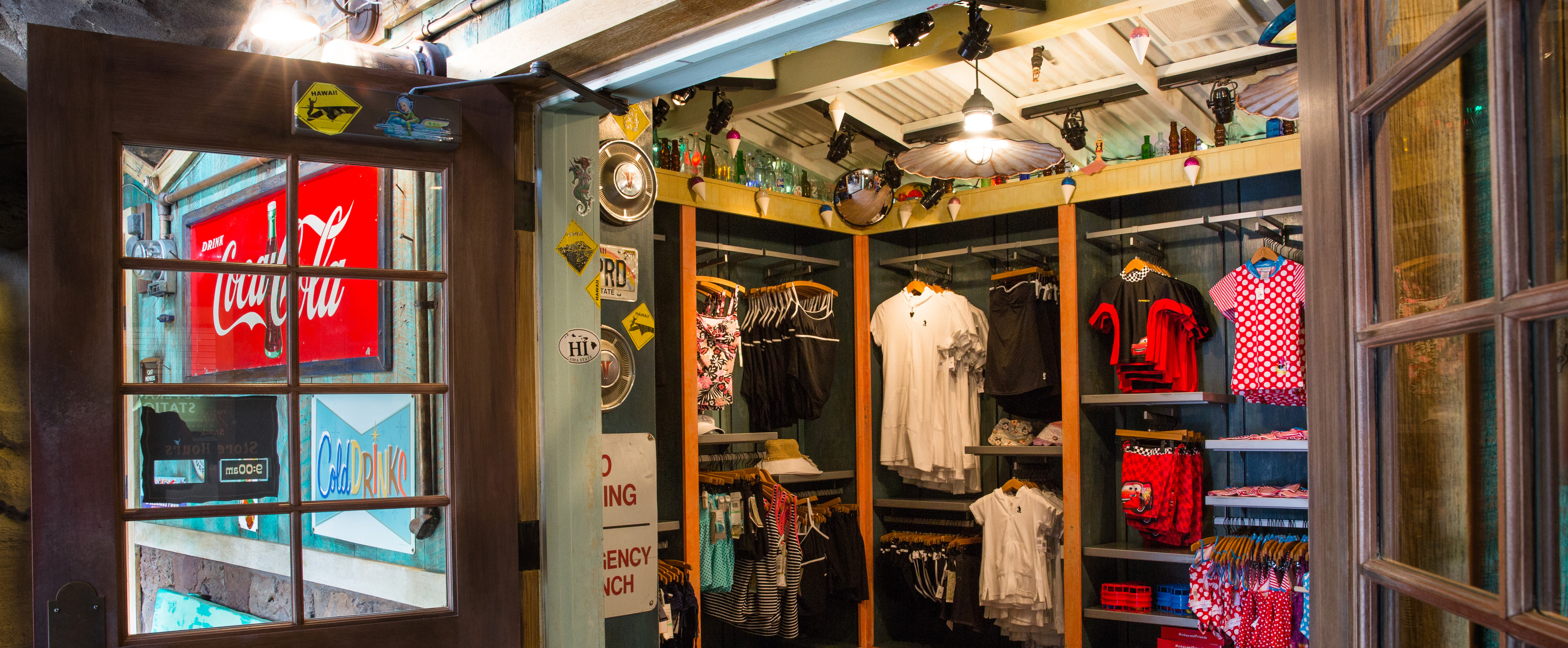 The open doors of Lava Shack snack shop, showing swim and beach wear hanging on wall racks
