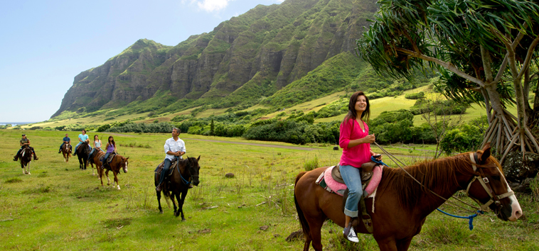 Kualoa Ranch Experience: Ride horses in lush valleys and on beautiful beaches.